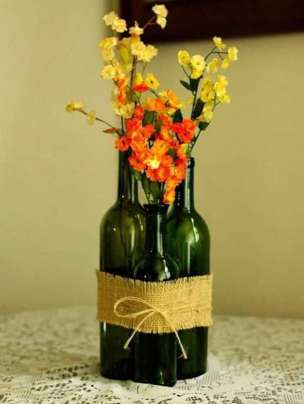 garrafa de vinho decorada com juta